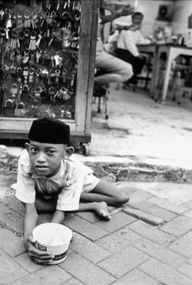 beggar with polio, indonesia